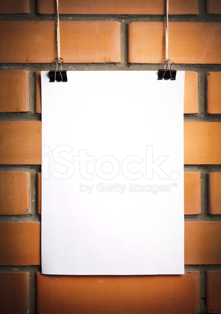 Blank White Poster on A Rope, Brick Wall Background Stock Photos