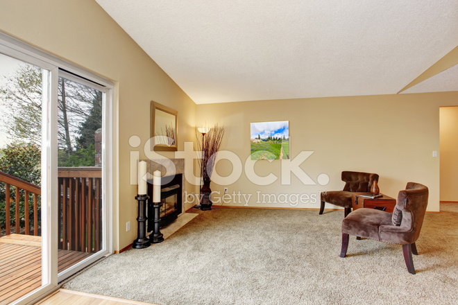 Empty Living Room In Soft Ivory With Fireplace Stock