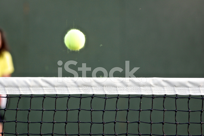 Blurred Tennis Ball Over Net Motion Blur Fuzz Flying Off Stock - why is there fuzz on a tennis ball