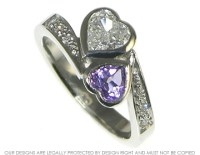 Bespoke platinum engagement ring with a heart shaped ...
