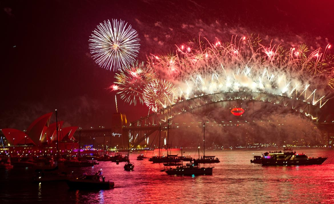 ... on as new year s eve fireworks erupt over the sydney harbour bridge on