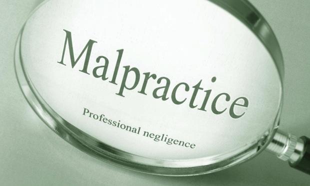 Malpractice Claim Against Public Defender Tossed Over