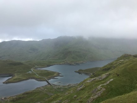 View of a loch on the way up the Pyg Track