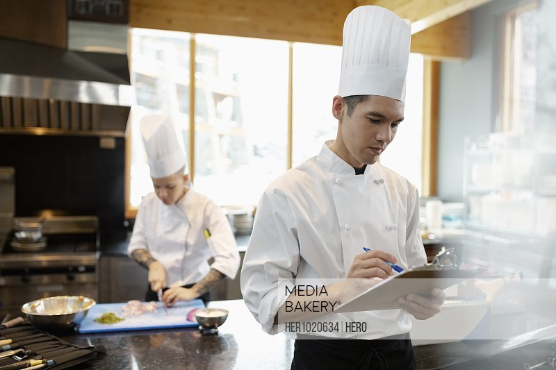 Mediabakery - Photo by Hero Images - Executive chef and prep cook