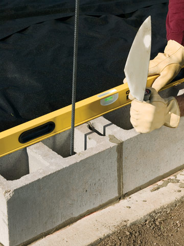 Building A Concrete-Block Retaining Wall - Building Masonry Walls