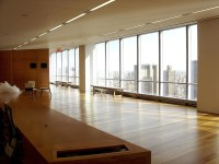 A Large Empty Room With Big Windows At The New York ...