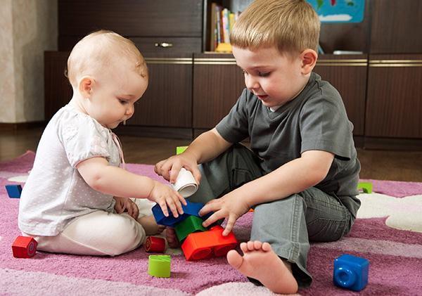 Babies Playing With Toys Toddler Gifts That Won 39;t Hurt Baby Siblings Parenting