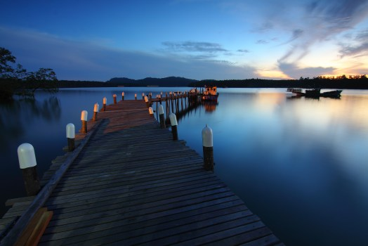 Adobe Stock Trial Brown Wooden Dock On Calm Body Of Water Surrounded By