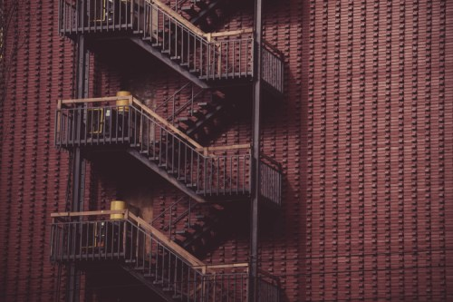 Grayscale Photo of Escape Stairs · Free Stock Photo