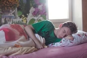 Man Wearing Green Printed Crew-neck Shirt While Sleeping
