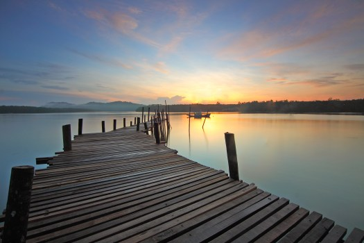 Windows 7 Original Wallpaper Hd Brown Wooden Dock On Calm Body Of Water Surrounded By