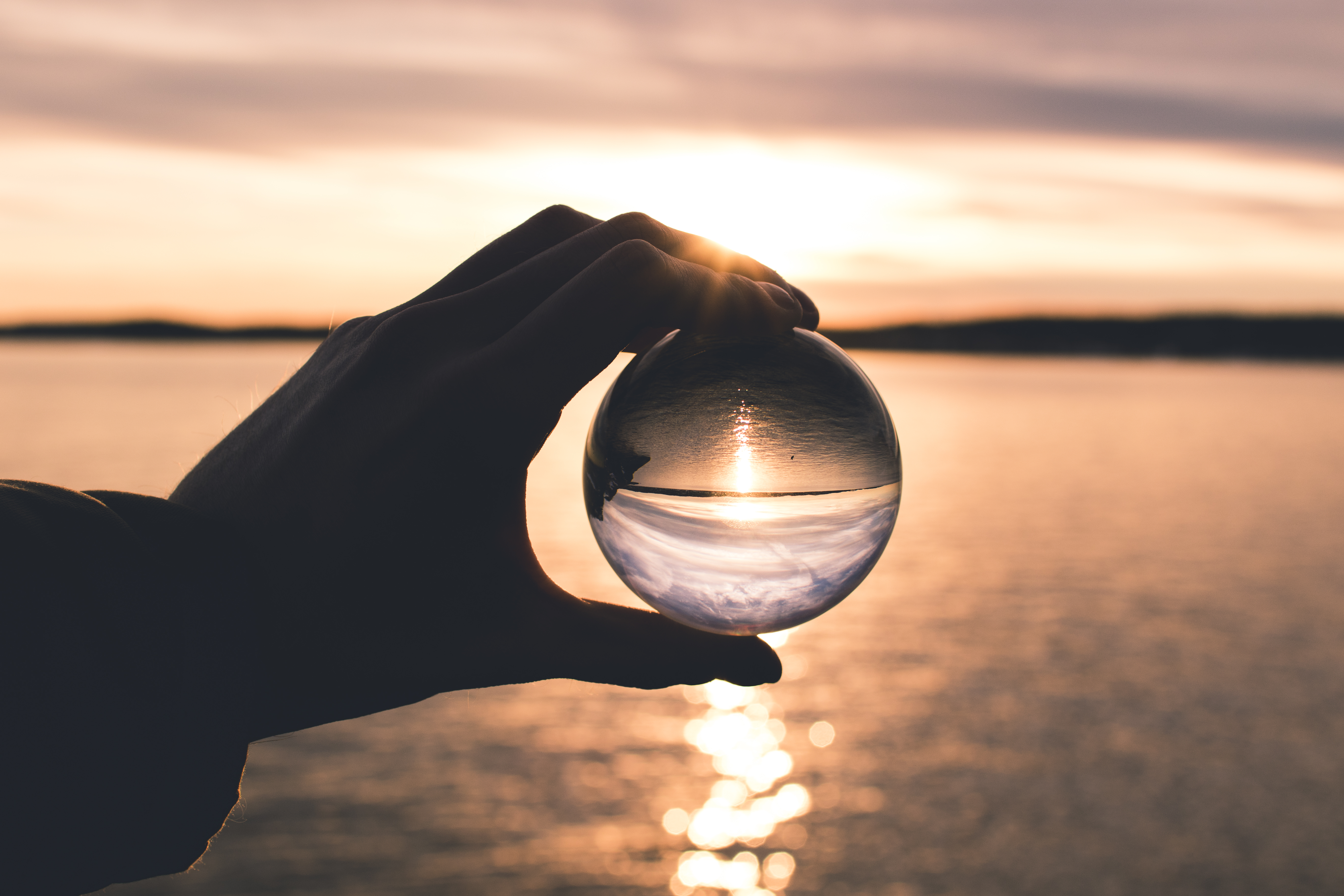 Photos Photo Displays Person Holding Ball With Reflection Of Horizon