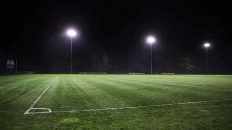 Car Streaks Wallpaper Nighttime Illuminated Soccer Field Pitch Stock Video