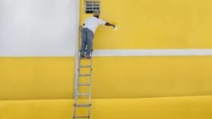 How do you paint over wallpaper?   Reference.com