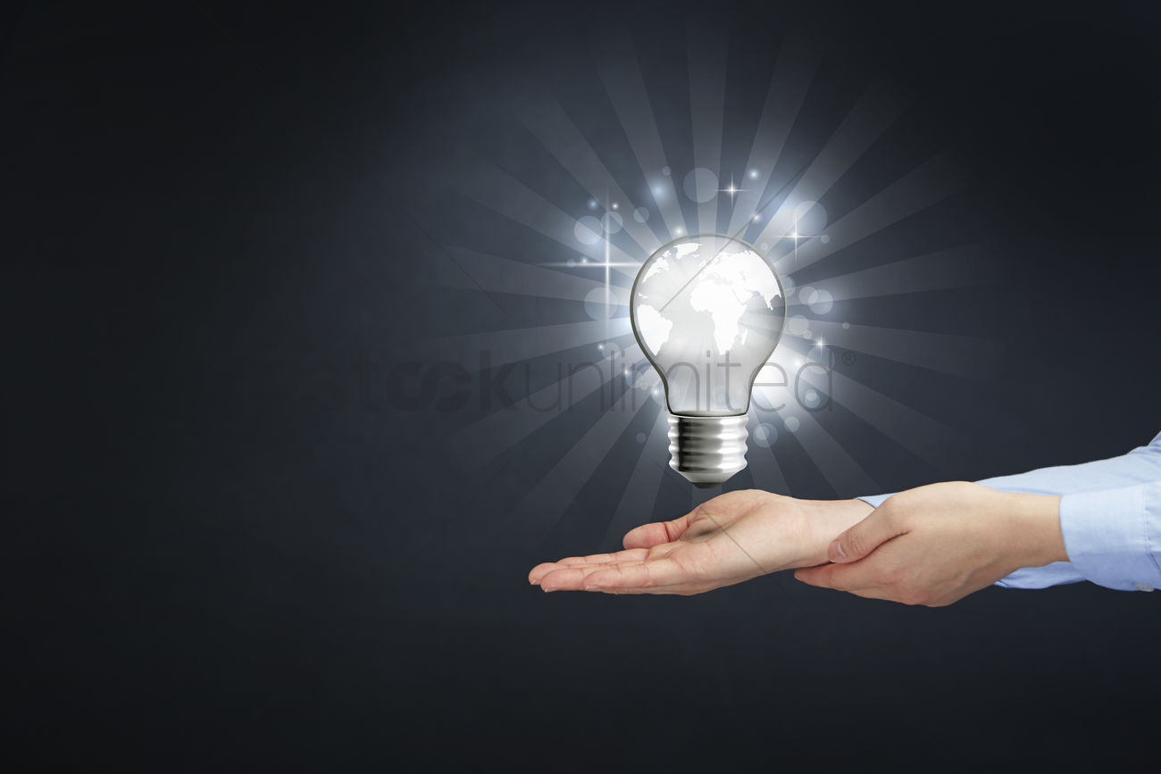 Glowing Bulb Animation Hands With A Glowing Earth Light Bulb Stock Photo