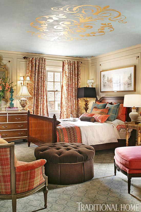 Decorating with Orange, an Instant Pick-Me-Up Traditional Home - orange and brown living room