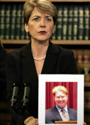 Martha Coakley, a Massachusetts district attorney, answers reporters' questions Monday about a radio talk show host's arrest.