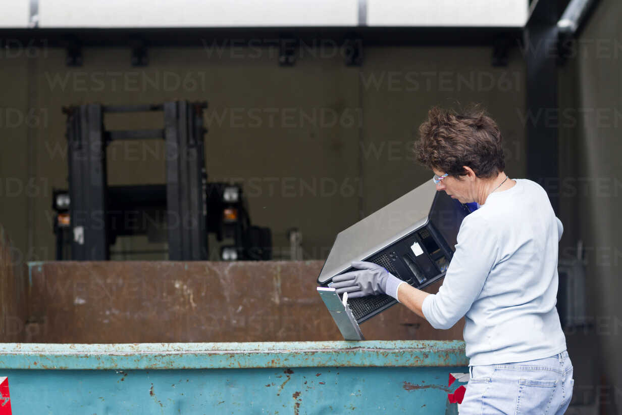 Woman At A Waste Container Throwing Away Old Desktop Pc Sgf001878 Sigrid Gombert Westend61