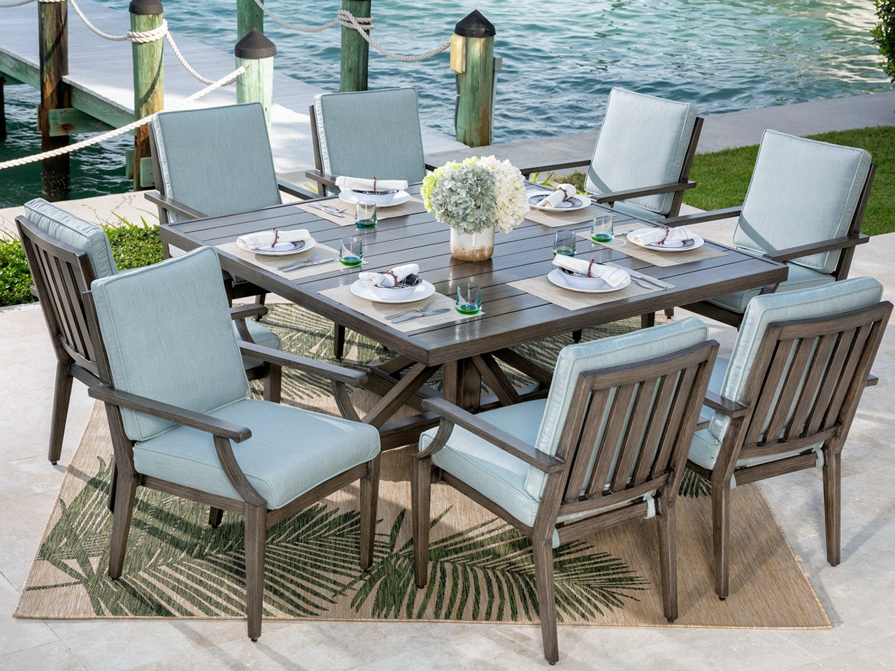 Living Room Monaco Weathered Teak Aluminum And Cast Mist Cushion 9 Pc Dining Set With 64 X 64 In