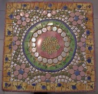 Small mosaic table top view using dishes, tiny tile and ...