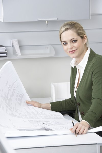 What Are the Duties of a Managing Editor? - Woman