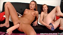 Blonde and redhead gape their holes with brutal dildos