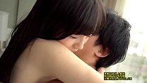 Asian couple in a hotel room