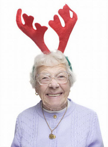 Crazy old lady wearing reindeer antlers.
