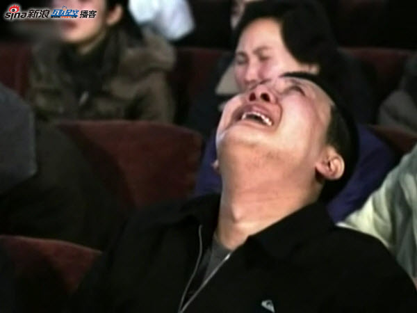 North Koreans react to news of Kim Jong Il's death as broadcasted by North Korea's state media.