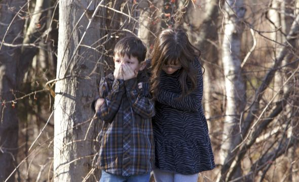 Two children standing outside Sandy Hook Elementary School.