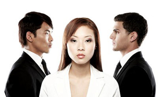 An Asian woman between an Asian man and a non-Asian man.