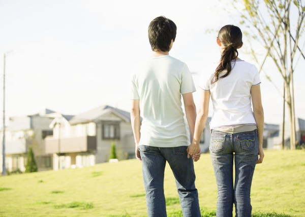 Asian couple holding hands.