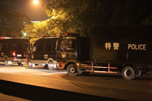 Chinese special police vehicles on the scene where a 62-year-old Chinese man in Baoshan district of Shanghai went on a killing spree with his hunting rifle.