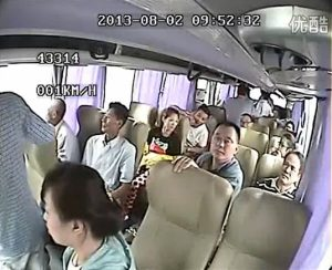 Passengers in a Chinese tour coach are thrown out of through the windows after the bus is rear-ended by a semi-trailer truck from behind while reversing on a highway in China.