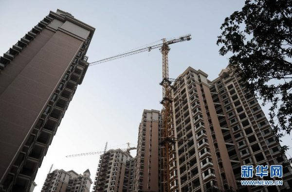 Residential apartment buildings under construction in China.