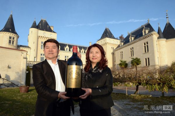 Chinese billionaire and vineyard owner celebrating the sale
