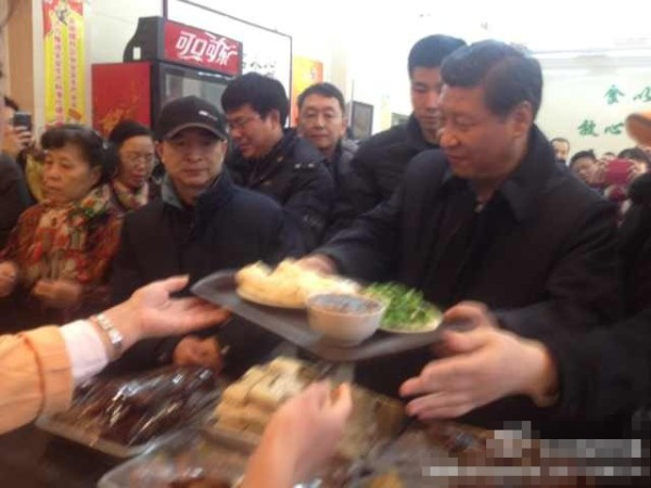 Chinese President Xi Jinping eating steamed buns with the common people.