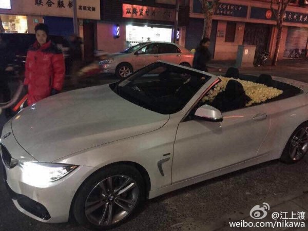 A homosexual marriage proposal in Shanghai, China involving a white BMW filled with white roses.
