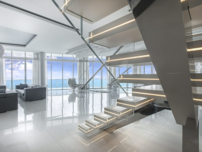 Corian® hanging stairs LUXO SURFACES By OFFICINE SANDRINI - house sale contract