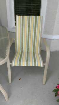 Used Glass Top Patio Table and Four Chairs in Ormond Beach