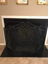 Black metal fireplace frame in Whitpain - letgo