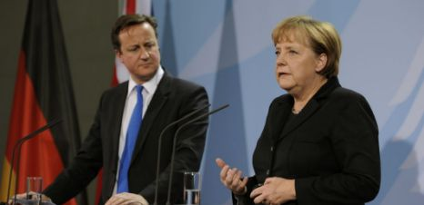 Prime Minister David Cameron and German Chancellor Angela Merkel address journalists before their meeting 