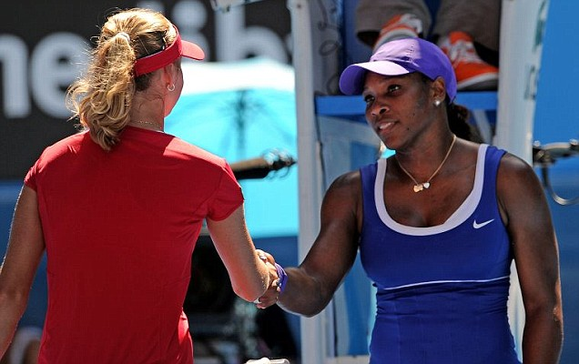 Serena Williams shakes hands with Ekaterina Makarova