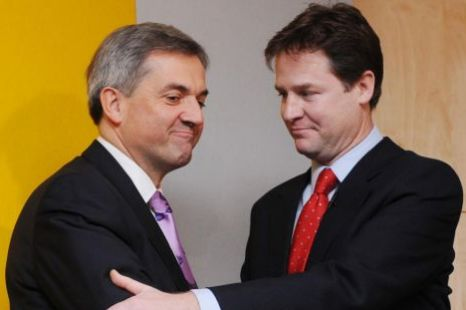 Chris Huhne (left) with Nick Clegg, charged, speeding.