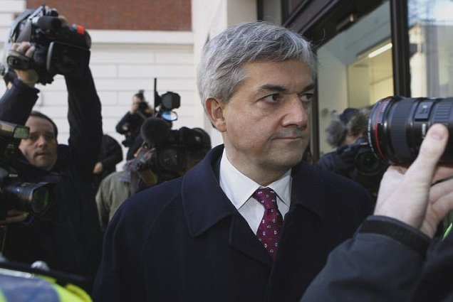 Former energy secretary Chris Huhne was mobbed by press as he arrived at Westminster Magistrates' Court