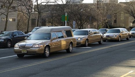 Whitney Houston funeral procession gold hearse coffin