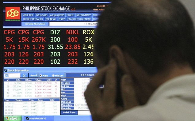 A trader monitors stock figures