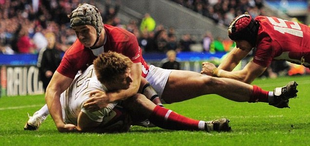 David Strettle of England Jonathan Davies and Leigh Halfpenny of Wales