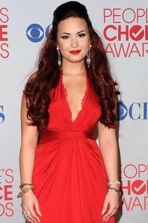 LOS ANGELES, CA - JANUARY 11:  Singer/Actress Demi Lovato poses with Favorite Pop Artist Award in the press room during the 2012 People's Choice Awards at Nokia Theatre L.A. Live on January 11, 2012 in Los Angeles, California.  (Photo by Jason Merritt/Getty Images)