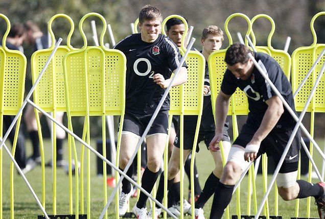 England's players work hard on their side-step during training yesterday